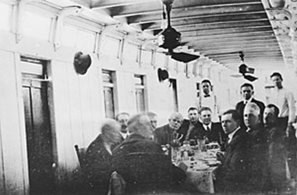 Inside the Harry Lee, men sitting around a table eating. Photo from University of Wisconsin-LeCrosse