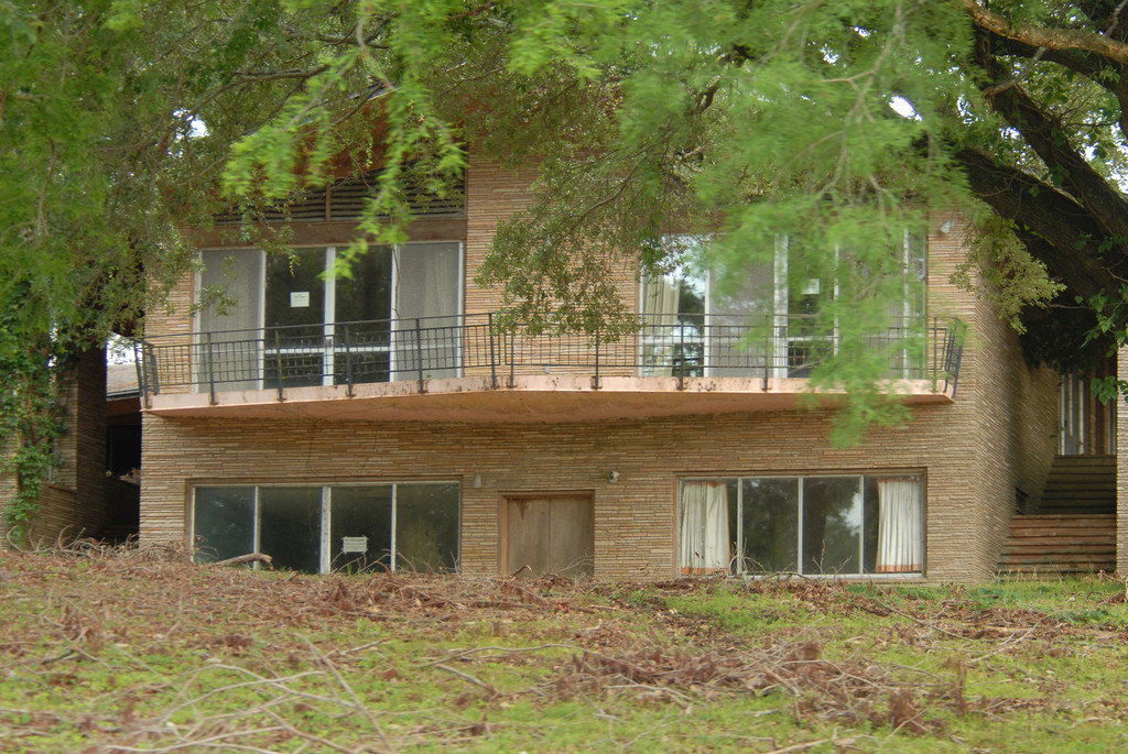 Split level house with wide open spaces and plenty of glass to see the beautiful landscape