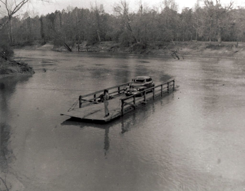 From the photo collection of D. T. Kent, this was taken near Kirbyville, Texas (Jasper County).  I believe it is on the Neches River, however, not the Sabine, though I do not k know for sure.  A reader had suggested it was Sheffield Ferry.  Kent's collection does contain some photos on or around the Sabine.