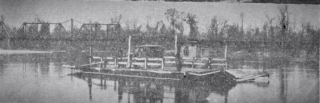 "1931. On the Sabine River between Merryville, Louisiana and Bon Weir, Texas. From The Beaumont Enterprise, ""The old hand-powered ferry which took its departure with the erection of the bridge. This is one of the old and historical crossings of the Sabine River."""