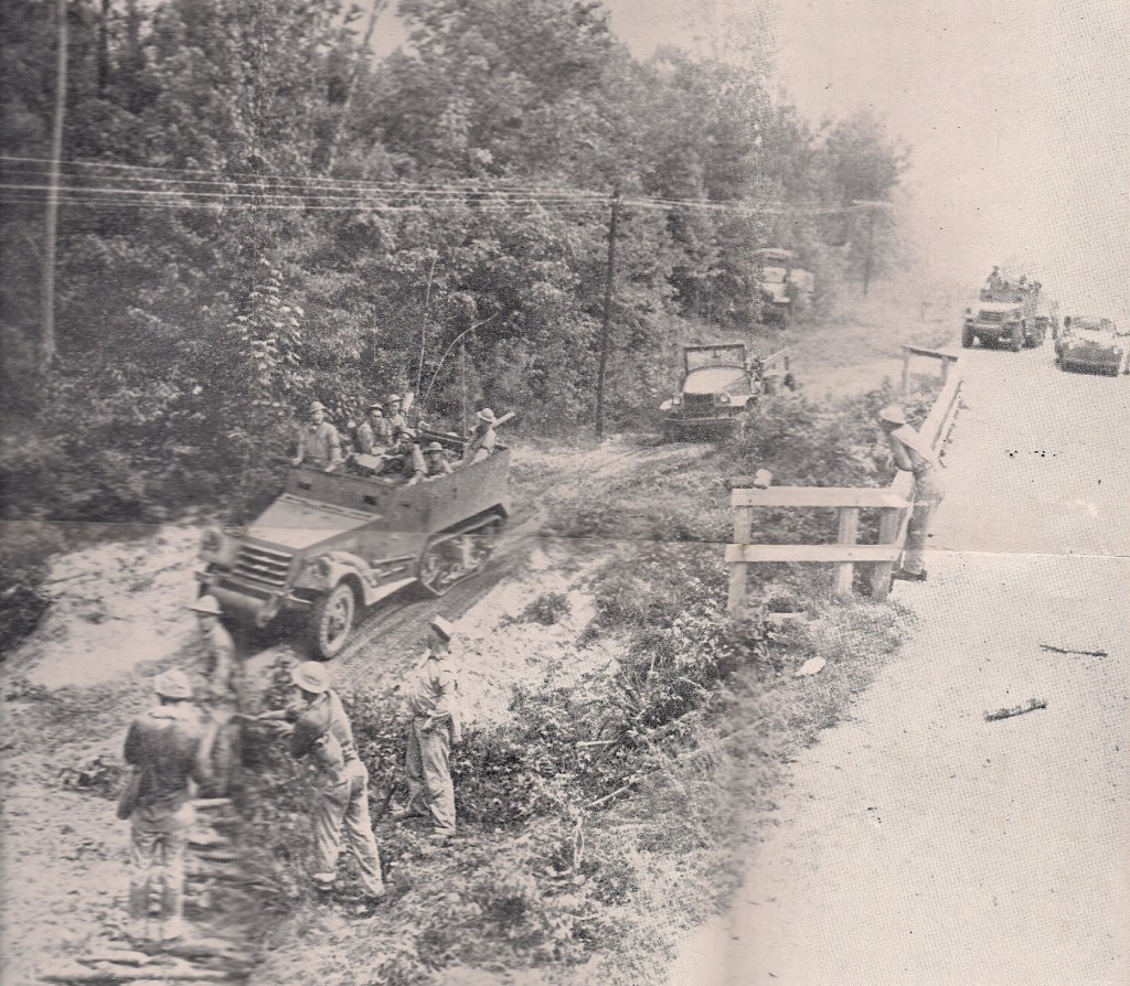 Tanks crossing and fording Kib Bayou/Kisatchie Bayou in the Peason Community during the maneuvers. This site is located on La. Hwy. 118 and is still visible. (Robertson Collection)