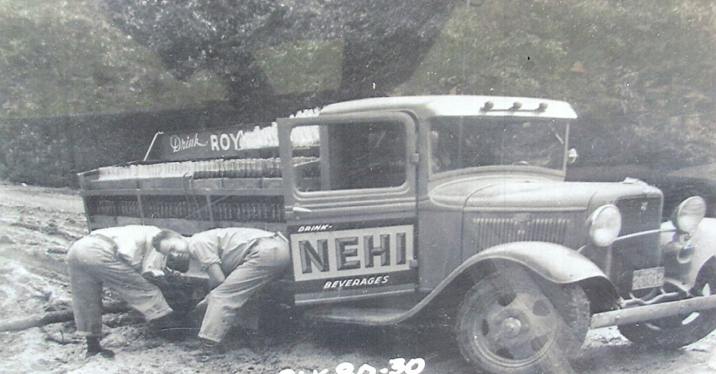 Delivery truck from the Many Nehi Bottling Company stuck in the mud while trying to deliver cold drinks to the rural stores in the Mount Carmel and Peason areas. Readers may be able to identify the two men in the picture who worked for Nehi. (Robertson Collection)